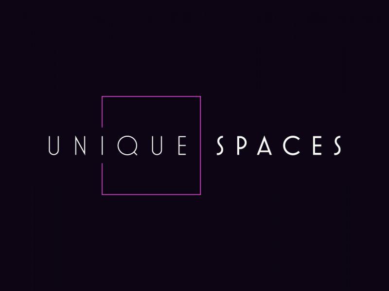 Unique Spaces Logo